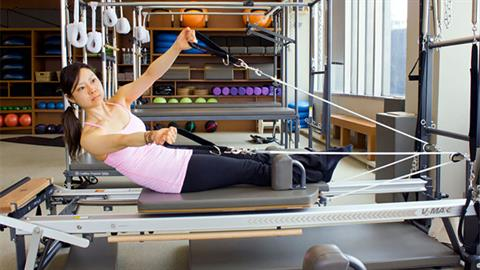 Roll Down with Obliques Exercise on the Reformer