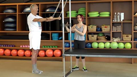 STOTT PILATES® for Active Aging: Trap Strengthener with Roll Down Bar on the Cadillac