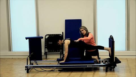 STOTT PILATES® At Home Cardio Workout Jump Series: Kick Backs: One Leg Jump