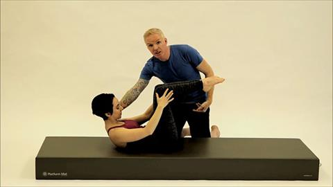 STOTT PILATES® for Triathletes: Swim Training: Double Leg Stretch