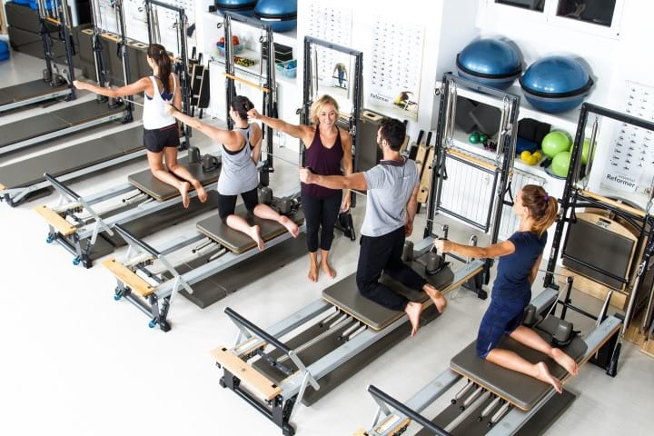 Claudia teaching a group Reformer class