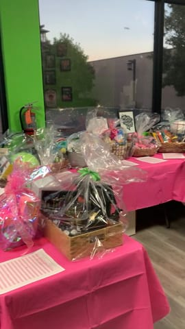 Charity raffle prizes on display at Wicked Pilates