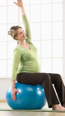 Woman stretching while seated on Stability Ball