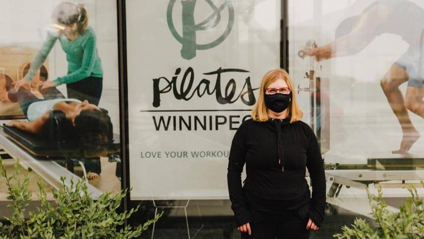 Norah Myers standing out front of Pilates Winnipeg