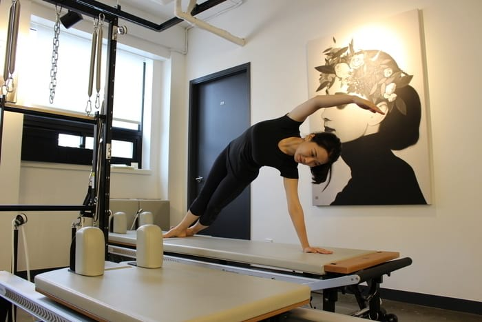 Julie Lee on the Pilates Reformer