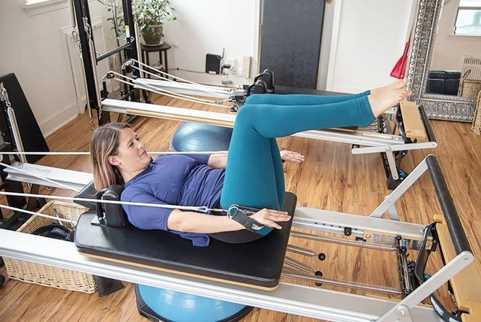 Jaylee Nickel on the Pilates Reformer
