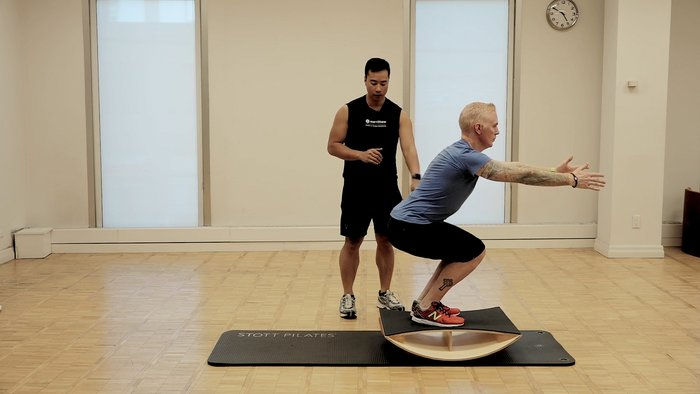 STOTT PILATES Rehab: Knee Injury: Squats on Stability Barrel