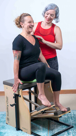 Magda working with a client on Stability Chair