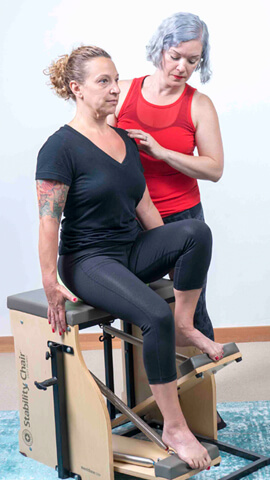 Magda instructing on Stability Chair