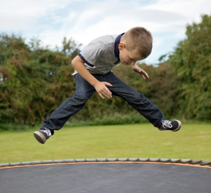 Kid on a trampoline