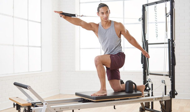 Instructor on a STOTT PILATES Reformer with Vertical Frame