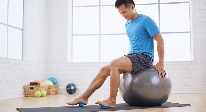 Student sitting on Stability Ball