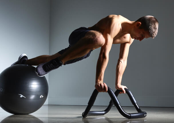 Instructor using Halo Trainer Plus and Stability Ball